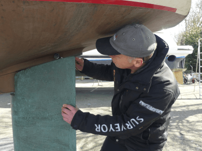 marine surveyor inspecting the rudder