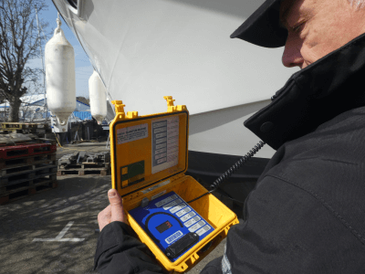 marine surveyor with moisture meter